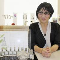 Megumi Ota's family tea plantation led her to experiment with and develop her own line of scented products. | KYODO