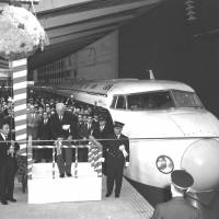 The first official departure of a bullet train on the Tokaido Shinkansen Line is marked with a ceremony at Tokyo Station on Oct. 1, 1964. The opening coincided with Tokyo hosting the Olympic Games, which started nine days later. | KYODO