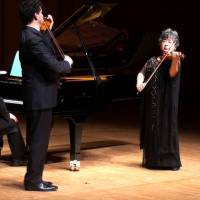Yuriko Kuronuma plays with her former student — world famous violinist Adrian Justus — and pianist Rafael Guerra at a concert in Tokyo in January 2013. | COURTESY OF YURIKO KURONUMA