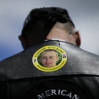 A Gulf War veteran wears a sticker in support of U.S. Army Sgt. Bowe Bergdahl at the 'Bring Bowe Back' rally in Hailey, Idaho, in June 2013. | AP
