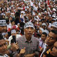 Indonesia candidate battles puppet image