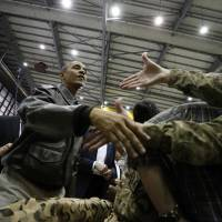 U.S. President Barack Obama meets troops during a visit to Bagram Air Base near Kabul on May 25. | REUTERS