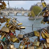 'Locks of love' cause heartbreak in Paris as bridge cracks under weight