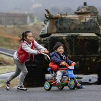 Military and civilian life intermingle in April on Baengnyeong Island, located on the South Korean side of the 'Northern Limit Line' in the Yellow Sea. | REUTERS