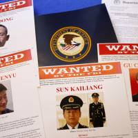 Press material is displayed at the Justice Department in Washington on May 19, before a news conference by U.S. Attorney General Eric Holder to announce charges against five Chinese military officers accused in an international cyber-espionage case. | AP