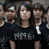 Student protesters in Hong Kong on Wednesday commemorate the 25th anniversary of China's 1989 pro-democracy uprising and its bloody suppression. They later held a candlelight vigil that organizers said drew around 180,000 people. | AFP-JIJI
