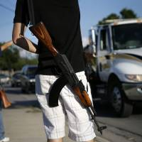 U.S. gun lobby backtracks on 'weird' criticism of 'open carry' rallies