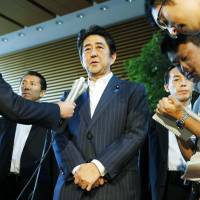 Abe to cut business tax but mum on how