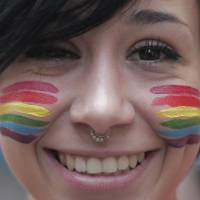 A girl with a rainbow painted on her face takes part in the annual lesbian, gay, bisexual and transgender pride parade in Turin, Italy, on Saturday. | AFP-JIJI