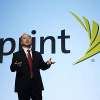 Masayoshi Son, head of SoftBank and Sprint, holds a news conference in Tokyo on May 7. | BLOOMBERG