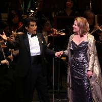 Haruhisa Handa, a baritone and the chairman of the International Foundation for Arts and Culture, left, and world-renowned soprano Renee Fleming sing the duet 'La ci darem la mano' from Don Giovanni at the Tokyo Global Concert on June 18. | IFAC