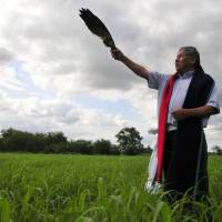 Tribal elder Gordon Yellowman uses an eagle wing in a ritual he performs as a sun dance priest for the Cheyenne-Arapaho tribe in El Reno, Oklahoma, on June 12.  | REUTERS