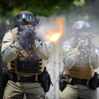 Ukrainian special forces fire their weapons during training in Kharkiv on Friday. As the crisis in the country festers, the United States is quietly considering deploying more of its own special forces to Eastern Europe. | AP