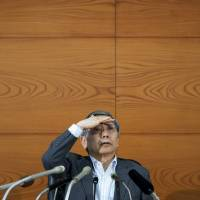 Bank of Japan Gov. Haruhiko Kuroda attends a news conference on June 13 at the central bank's headquarters in Tokyo. | BLOOMBERG