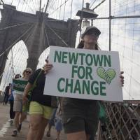 Marchers call for action after U.S. mass shootings