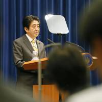 Prime Minister Shinzo Abe unveils a set of economic reform strategies on Tuesday that includes a pledge to help working women. | KYODO