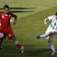 Messi magic leads Argentina past Iran