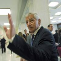 U.S. Defense Secretary Chuck Hagel arrives on Capitol Hill in Washington on Wednesday to testify before the House Armed Services Committee about the Obama administration's prisoner swap with the Afghan Taliban. | AP