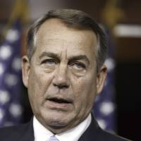House Speaker John Boehner of Ohio arrives for a news conference on Capitol Hill on Wednesday. Boehner said the Republican-controlled House of Representatives will file an election-year lawsuit accusing President Barack Obama of failing to carry out the laws passed by Congress. | AP