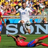 Costa Rica tops group after England stalemate