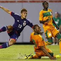 On to Brazil: Yoshito Okubo watches his shot during Japan's friendly against Zambia on Friday in Tampa, Florida. Okubo's shot found the back of the net to help give Japan a 4-3 win. | REUTERS