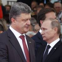 Putin meets with Ukraine president-elect at French D-Day event