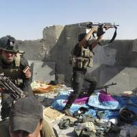 Iraqi Special Operations Forces members take positions during clashes with Islamic State of Iraq and Syria militants in Ramadi on Thursday. | REUTERS