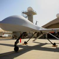 An MQ-4 Predator drone operated by the U.S. Air Force is seen on the tarmac at Balad Air Base, north of Baghdad, in June 2007. A Pentagon official says the U.S. has started flying armed drones over the Iraqi capital to protect U.S. civilians and military forces in the city. | AP