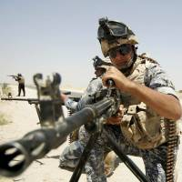Iraqi security forces patrol the border between Karbala and al-Anbar provinces on Monday following gains by Sunni Islamist insurgents further north. A global security report released Wednesday said world peace has declined steadily over the last seven years. | REUTERS