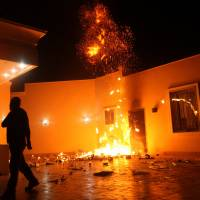 The U.S. Consulate in Benghazi, Libya, seen during a Sept. 11, 2012, attack by an armed group. Ahmed Abu Khatallah, a key suspect, was captured by U.S. special forces over the weekend, U.S. officials said Tuesday. | REUTERS