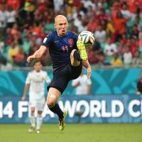 Sweet revenge: Arjen Robben controls the ball during the Netherlands' 5-1 victory over Spain on Friday in Salvador, Brazil.   AP