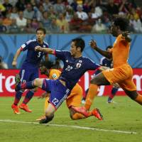 Heart breaker: Cote d'Ivoire forward Gervinho (second from left) scores the winning goal in the 66th minute in Japan's 2-1 loss to the Africans on Saturday. | REUTERS