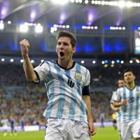 Under the bright lights: Argentina's Lionel Messi celebrates following his goal against Bosnia-Herzegovina on Sunday in Rio de Janeiro. | AFP-JIJI