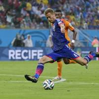 First blood: Keisuke Honda gives Japan the lead in the 16th minute in Saturday's World Cup Group C game against Cote d'Ivoire. | AP