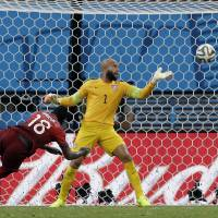 Better late than never: Portugal's Silvestre Varela heads the ball past United States goalkeeper Tim Howard during extra time on Sunday in Manaus, Brazil. The match ended 2-2 draw. | AP