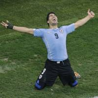 The stuff of dreams: Luis Suarez celebrates after scoring against England during Uruguay's 2-1 win on Thursday in Sao Paulo. | AP