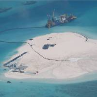 China building up more land at Spratly reefs, Manila says