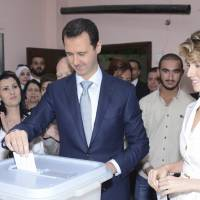As civil war rages, Syrians vote in preordained presidential election