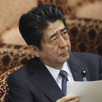 Abe vows to start cutting corporate tax in fiscal 2015