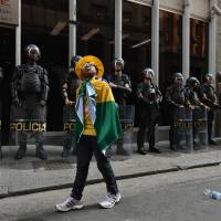 Brazil wrestles with pride, frustration over World Cup as kickoff nears