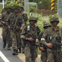 Military surrounds South Korean soldier who killed five comrades