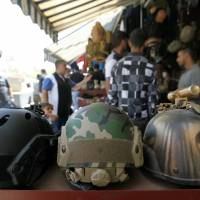 Bullets and boots: Shiite Iraqi volunteers snap up military gear ahead of offensive
