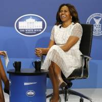 Robin Roberts (left) of ABC News and U.S. first lady Michelle Obama discuss proposals to make U.S. workplaces more women-friendly at the White House Summit on Working Families in Washington on Monday. President Barack Obama has said the U.S. should 'join the rest of the industrialized world' in offering paid maternity leave to expecting mothers, decrying the fact that the country stands alone in failing to make such provision. REUTERS