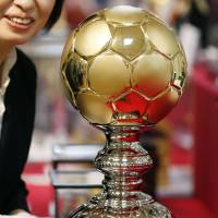 A 3-kg gold soccer ball, priced at almost ¥43 million, is put on display Thursday at the Takashimaya Co. department store in Tokyo's Nihonbashi neighborhood. | KYODO