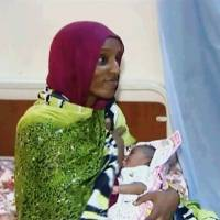 A video grab shows Meriam Ibrahim breast-feeding her newborn baby girl at a prison in Khartoum this month. | AP