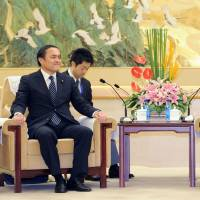 Yu Zhengsheng (right), the fourth-highest ranking member of the Chinese Communist Party meets with Tadatomo Yoshida, head of Japan's Social Democratic Party, on Tuesday in Beijing. | POOL PHOTO/KYODO