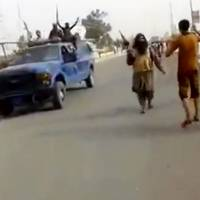 Militants from the al-Qaida-inspired Islamic State of Iraq and Syria arrive at Iraq's largest oil refinery in Beiji, some 250 km (155 miles) north of Baghdad on Tuesday, in this video grab taken from a militant social media account. | AP