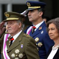 Spain's Crown Prince Felipe (center), King Juan Carlos (left) and Queen Sofia (right) attend the annual Pascua Militar Epiphany ceremony at the Royal Palace in Madrid n Jan. 6. Spain's King Juan Carlos plans to abdicate and pave the way for his son, Crown Prince Felipe, to take over, Spanish Prime Minister Mariano Rajoy told the country Monday. | AP