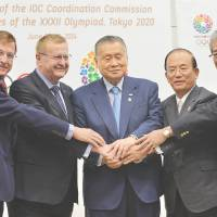 All for 2020: (From left) IOC Executive director for the Olympic Games Gilbert Felli, IOC vice president John Coates, Tokyo 2020 Olympic Committee president Yoshiro Mori, Tokyo 2020 CEO Toshio Muto, and JOC president Tsunekazu Takeda pose for pictures at a news conference on Friday. | AFP-JIJI