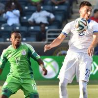 Looking ahead: Greece's Andreas Samaris controls the ball as Nigeria's Ogenyi Onazi looks on during their 0-0 friendly draw in Chester, Pennsylvania on Tuesday. | AFP-JIJI